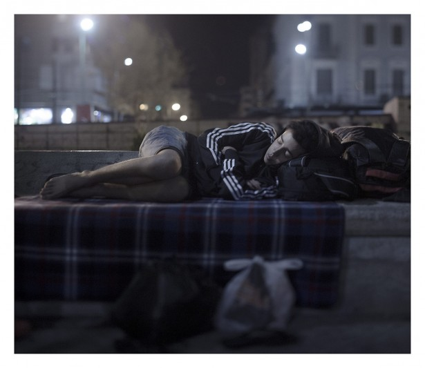 "EXCLUSIVE, SPECIAL FEES APPLY. Must Credit - Magnus Wennman/Rex Mandatory Credit: Photo by Must Credit - Magnus Wen/REX Shutterstock (2853832b) Abdul Karim, 17, sleeping in Omonoia Square in Athens, Greece Magnus Wennman: Where the children Sleep - 27 Sep 2015 Abdul Karim Addo has no money left. He bought a ferry ticket to Athens with his last euros. Now he spends the night in Omonoia Square, where hundreds of refugees are arriving every day. Here smugglers are making big money arranging false passports as well as bus and plane tickets to people in flight - but Abdul Karin is not going anywhere. He is able to borrow a telephone and call home to his mother in Syria, but he is not able to tell her how bad things are. ""She cries and is scared for my sake and I don't want to worry her more"". He unfolds his blanket in the middle of the square and curls up in the fetal position. ""I dream of two things: to sleep in a bed again and to hug my younger sister""."