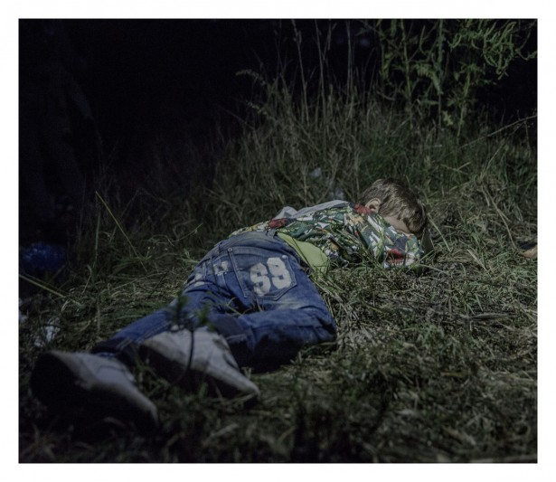 "EXCLUSIVE, SPECIAL FEES APPLY. Must Credit - Magnus Wennman/Rex Mandatory Credit: Photo by Must Credit - Magnus Wen/REX Shutterstock (2853832c) Ahmed, 6, sleeping on the ground in Horgos, Serbia Magnus Wennman: Where the children Sleep - 27 Sep 2015 It is after midnight when Ahmed falls asleep in the grass. The adults are still sitting around, formulating plans for how they are going to get out of Hungary without registering themselves with the authorities. Ahmed is six years old and carries his own bag over the long stretches that his family walks by foot. ""He is brave and only cries sometimes in the evenings,"" says his uncle, who has taken care of Ahmed since his father was killed in their hometown Deir ez-Zor in northern Syria."