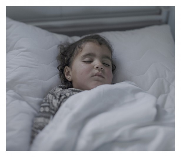 "EXCLUSIVE, SPECIAL FEES APPLY. Must Credit - Magnus Wennman/Rex Mandatory Credit: Photo by Must Credit - Magnus Wen/REX Shutterstock (2853832h) Iman, 2, in a hospital bed in Azraq, Jordan Magnus Wennman: Where the children Sleep - 27 Sep 2015 Iman, 2, has pneumonia and a chest infection. This is her third day in this hospital bed. ""She sleeps most of the time now. Normally she's a happy little girl, but now she's tired. She runs everywhere when she's well. She loves playing in the sand"", says her mother Olah, 19."