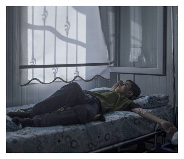 "EXCLUSIVE, SPECIAL FEES APPLY. Must Credit - Magnus Wennman/Rex Mandatory Credit: Photo by Must Credit - Magnus Wen/REX Shutterstock (2853832o) Mohammed, 13, in hospital in Nizip, Turkey Magnus Wennman: Where the children Sleep - 27 Sep 2015 Mohammed, 13, loves houses. Back home in Aleppo he used to enjoy walking around the city looking at them. Now many of his favourite buildings are gone, blown to pieces. Lying in his hospital bed he wonders whether he will ever fulfill his dream of becoming an architect. ""The strangest thing about war is that you get used to feeling scared. I wouldn't have believed that"", says Mohammed."