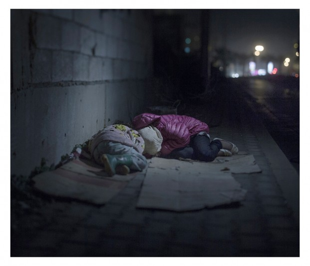EXCLUSIVE, SPECIAL FEES APPLY. Must Credit - Magnus Wennman/Rex Mandatory Credit: Photo by Must Credit - Magnus Wen/REX Shutterstock (2853832p) Ralia, 7 and Rahaf, 13, sleeping on the street in Beirut Magnus Wennman: Where the children Sleep - 27 Sep 2015 Ralia, 7, and Rahaf, 13, live on the streets of Beirut. They are from Damascus, where a grenade killed their mother and brother. Along with their father they have been sleeping rough for a year. They huddle close together on their cardboard boxes. Rahaf says she is scared of 'bad boys' at which Ralia starts crying.