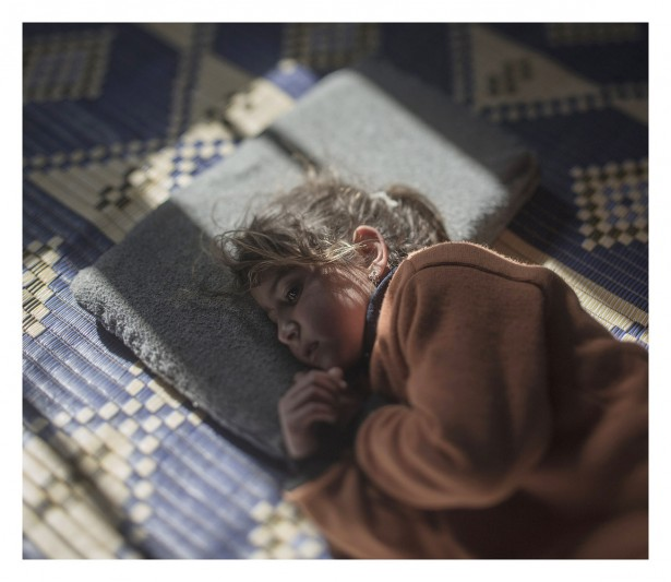 EXCLUSIVE, SPECIAL FEES APPLY. Must Credit - Magnus Wennman/Rex Mandatory Credit: Photo by Must Credit - Magnus Wen/REX Shutterstock (2853832t)  Tamam, 5, in Azraq, Jordan Magnus Wennman: Where the children Sleep - 27 Sep 2015 Five-year-old Tamam is scared of her pillow. She cries every night at bedtime. The air raids on her hometown of Homs usually took place at night, and although she has been sleeping away from home for nearly two years now, she still doesn't realize that her pillow is not the source of danger.