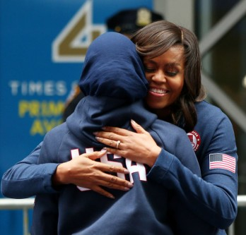 NEW YORK, NY - APRIL 27:  First lady of the United States Michelle Obama hugs Ibtihaj Muhammad during a fencing demonstration at Team USA's Road to Rio Tour presented by Liberty Mutual on April 27, 2016 in New York City. The event marks 100 days until the Opening Ceremony of the Rio 2016 Olympic Games.  (Photo by Elsa/Getty Images for USOC)