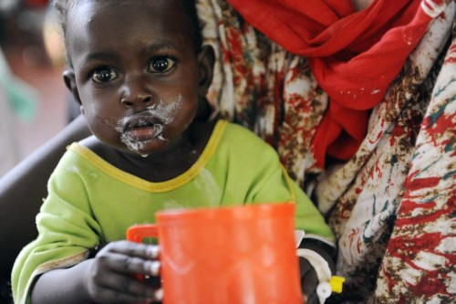 Somali refugee child Mohamed Abdullah, 1, drinks specialized baby formula as part of treatment for complications from severe malnourishment in the stabilization unit of the International Rescue Committee hospital at Hagadera settlement in Kenya's Dadaab Refugee Camp, August 31, 2011.  REUTERS/Jonathan Ernst