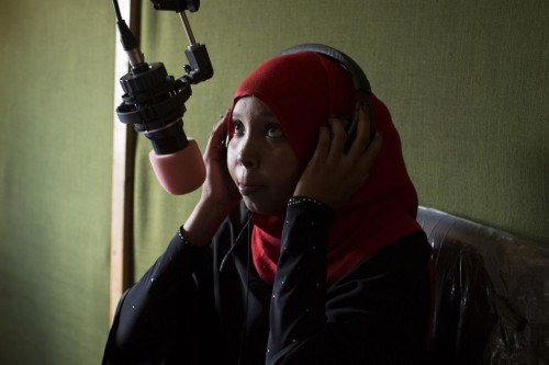 "A radio presenter prepares to talk on air during a live interview at the ""Gargaar"" (Help in Somali) Star FM, a local radio station for refugee voices at a UNHCR field office in Hagadera, one of the several refugee settlements in Dadaab, October 8, 2013.  REUTERS/Siegfried Modola"