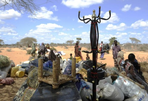 Refugees who have been living in the outskirts of the proper camps in Hagadera gather their belongings onto trucks as they choose to relocate to the newly-opened Kambioos settlement, at Kenya's Dadaab Refugee Camp,  August 29, 2011.  REUTERS/Jonathan Ernst