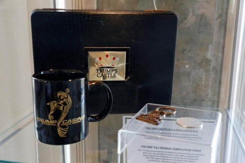 A Trump Castle gambling chips box, Trump Casino coffee cup, Trump Taj Mahal key chain, and Trump Castle gaming token are displayed at The Trump Museum near the Republican National Convention in Cleveland, Ohio, U.S., July 19, 2016.  REUTERS/Lucas Jackson