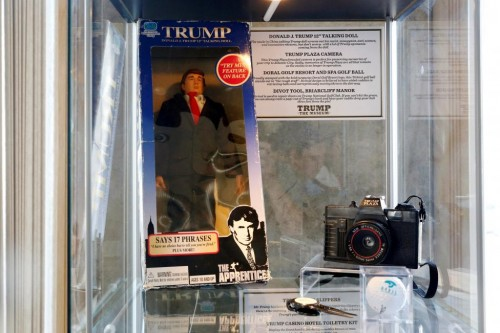 """A Donald J. Trump 12"""" talking doll, Trump Plaza camera, Doral Golf Resort & Spa golf ball and a divot tool from Briarcliff Manor are displayed at The Trump Museum near the Republican National Convention in Cleveland, Ohio, U.S., July 19, 2016.  REUTERS/Lucas Jackson"""