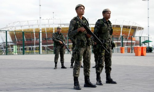 Brazilian Army Forces soldiers patrol outside the 2016 Rio Olympics Park in front of the tennis center court venue in Rio de Janeiro, Brazil. REUTERS/Fabrizio Bensch