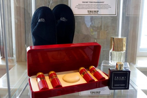 """Trump Soho slippers, a Trump Casino Hotel toiletry kit, and Trump """"The Fragrance"""" are displayed at The Trump Museum near the Republican National Convention in Cleveland, Ohio, U.S., July 19, 2016.  REUTERS/Lucas Jackson"""