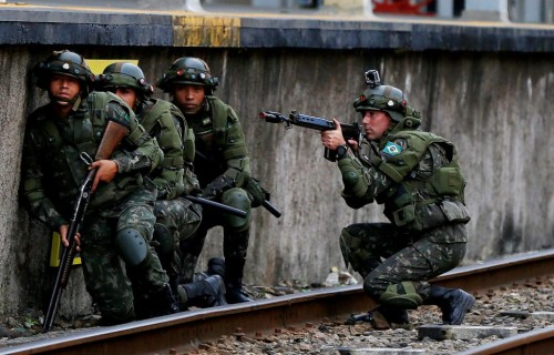 Brazilian army soldiers are pictured as they attend an exercise during terrorist attack simulation at a train station, ahead of the Rio 2016 Olympic Games in Rio de Janeiro, Brazil. REUTERS/Bruno Kelly