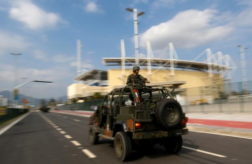 Brazilian Army soldiers patrol in front of the Olympic park ahead of the 2016 Rio Olympics in Rio de Janeiro, Brazil. REUTERS/Bruno Kelly