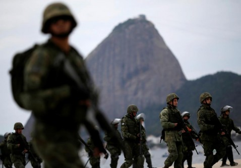 Brazilian Navy soldiers attend an exercise on Flamengo beach ahead of the 2016 Rio Olympics in Rio de Janeiro, Brazil. REUTERS/Ueslei Marcelino