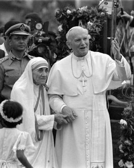Pope John Paul II holds hands with Mother Teresa after visiting the Casa del Cuore Puro, Mother Teresa