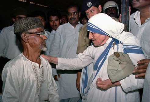 Nobel Peace Laureate Mother Teresa talking to a Bangladeshi man after she opens an old people