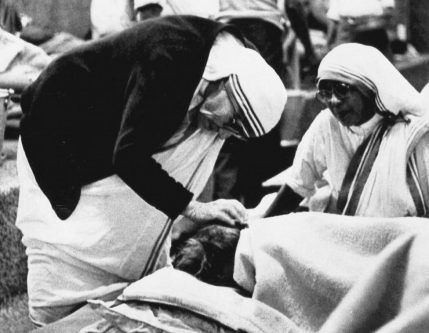 Mother Teresa attends to a patient in her home for the dying in Calcutta