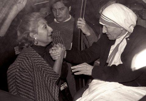 A devotee grasps Mother Teresa of Calcutta