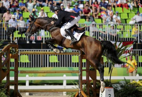 Nick Skelton of Britain riding Big Star competes. The 58-year-old, who is competing in this seventh Olympics and helped win a team gold at London 2012, went clear on Big Star in 42.82 seconds.REUTERS/Tony Gentile