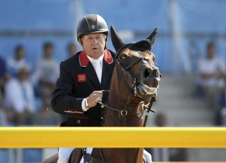 Nick Skelton of Britain riding Big Star competes. REUTERS/Tony Gentile