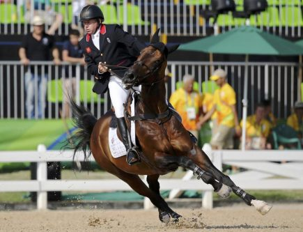 Nick Skelton of Britain riding Big Star competes in individual jumping. Skelton won gold in show jumping after a fast and penalty-free jumpoff that none of the five riders who followed could catch. REUTERS/Tony Gentile