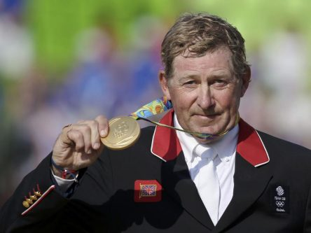 Nick Skelton of Britain poses with his gold medal afyter the individual jumping event. REUTERS/Tony Gentile