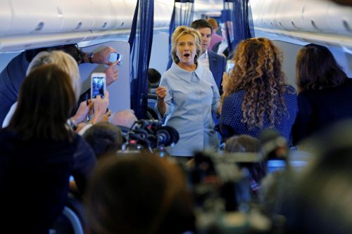 Hillary Clinton greets members of the news media on her newly unveiled campaign plane. The Labor Day holiday is the traditional kickoff to the frenzied, last stretch of campaigning ahead of the November 8 election, and both Trump and Clinton chose to begin their day in Cleveland. REUTERS/Brian Snyder