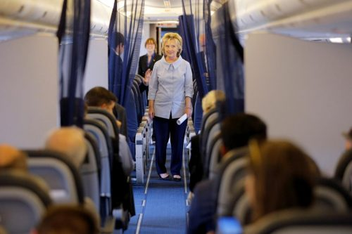 Hillary Clinton walks through her newly unveiled campaign plane. REUTERS/Brian Snyder