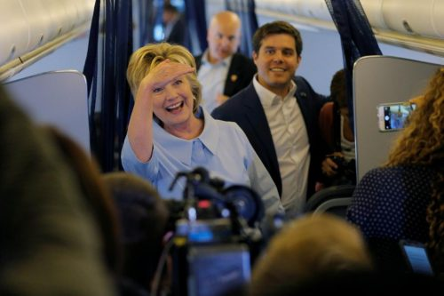 Hillary Clinton greets members of the news media on her newly unveiled campaign plane. REUTERS/Brian Snyder