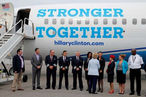 Hillary Clinton greets flight crew and others before boarding her newly unveiled campaign plane. REUTERS/Brian Snyder