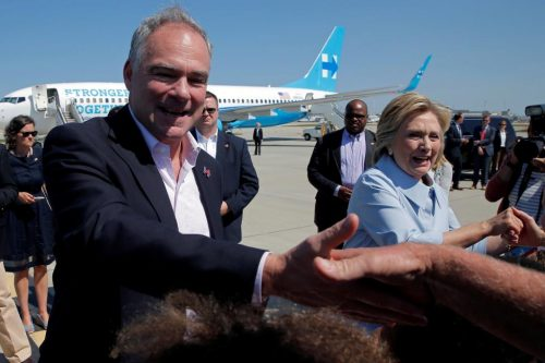 Vice-presidential candidate and Senator Tim Kaine and Hillary Clinton greet well-wishers in Cleveland, Ohio. REUTERS/Brian Snyder