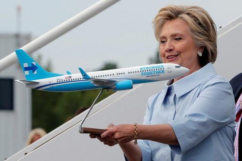 "Democratic presidential nominee Hillary Clinton holds a model of her newly unveiled campaign plane before boarding for the first time at the Westchester County Airport in White Plains, New York, September 5, 2016. Clinton, scheduled to make a stop at a local business before marching in a Labor Day parade, told the press corps - traveling on the same plane with her for the first time - that it was the ""last moment before the mad dash"" to the White House. REUTERS/Brian Snyder"