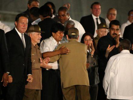 Bolivia's President Evo Morales and Cuba's President Raul Castro embrace. REUTERS/Carlos Garcia Rawlins