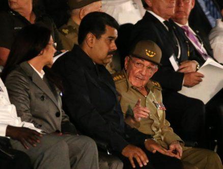 Venezuelan President Nicolas Maduro listens to Cuban President Raul Castro as Maduro's wife Cilia Flores looks on. REUTERS/Carlos Garcia Rawlins