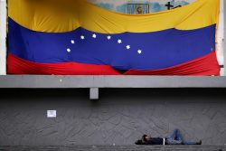 A man is seen sleeping at the square in Caracas, Venezuela