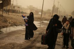 Iraqi people flee the Islamic State stronghold of Mosul in al-Samah neighborhood, Iraq