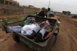 Iraqi people ride in a vehicle as they flee the Islamic State stronghold of Mosul in al-Samah neighborhood, Iraq