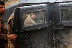 An Iraqi woman, who was wounded during clashes in the Islamic State stronghold of Mosul, is brought into a field hospital in al-Samah neighborhood, Iraq