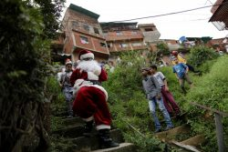 Santa Claus walks during a visit to residents of the slum of Petare in Caracas