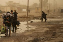 Iraqi people flee the Islamic State stronghold of Mosul in al-Samah neighborhood Iraq