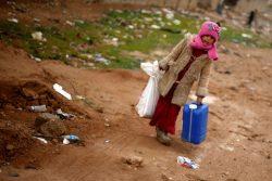 Iraqi girl carries belongings as she flees the Islamic State stronghold of Mosul in al-Samah neighborhood