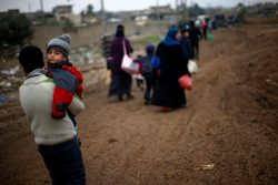 Iraqi people flee the Islamic State stronghold of Mosul in al-Samah neighborhood
