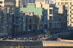 Military vehicles transporting the ashes of Cuba's late President Fidel Castro pass along the Malecon seawall in Havana