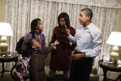President elect Barack Obama and Michelle Obama get their daughters ready for school in Washington
