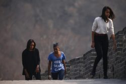 U.S. first lady Michelle Obama walks with her daughters Sasha and Malia as they climb the steps at the Mutianyu section of the Great Wall of China, in Beijing
