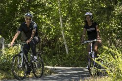 U.S. President Obama cycles with his daughter Malia during their family vacation at Martha's Vineyard in Massachusetts