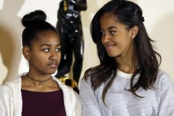 Sasha and Malia Obama listen to their father at the National Thanksgiving Turkey pardoning at White House in Washington