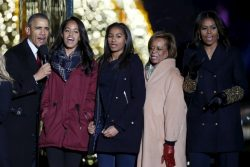 U.S. President Barack Obama and family sing Christmas carols during the National Christmas Tree Lighting and Pageant of Peace ceremony in Washington