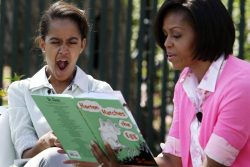 Malia Obama yawns as she listens to Michelle Obama read at the annual Easter Egg Roll on the South Lawn of the White House in Washington
